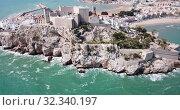 Купить «Picturesque aerial view of medieval Peniscola Castle on rocky hilltop on Mediterranean coast, Spain», видеоролик № 32340197, снято 16 апреля 2019 г. (c) Яков Филимонов / Фотобанк Лори