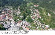 Купить «Picturesque aerial view of Idrija town center in sunny autumn day, Gorizia, Slovenia», видеоролик № 32340281, снято 4 сентября 2019 г. (c) Яков Филимонов / Фотобанк Лори
