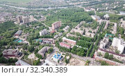 Купить «Aerial panoramic view of modern cityscape of Voskresensk overlooking Church of Icon of Mother of God of Jerusalem, Russia», видеоролик № 32340389, снято 12 мая 2019 г. (c) Яков Филимонов / Фотобанк Лори