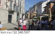 Купить «View of old town streets of Italian city of Lecco on background of San Martino mountain at sunny day», видеоролик № 32340597, снято 1 сентября 2019 г. (c) Яков Филимонов / Фотобанк Лори