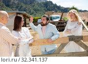 Купить «Displeased couples talking through wooden fence», фото № 32341137, снято 11 апреля 2019 г. (c) Яков Филимонов / Фотобанк Лори