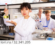 Купить «Chinese student working in university laboratory», фото № 32341205, снято 28 мая 2019 г. (c) Яков Филимонов / Фотобанк Лори