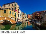 Купить «View of canals and cityscape with colorful buildings in Venice», фото № 32341329, снято 5 сентября 2019 г. (c) Яков Филимонов / Фотобанк Лори