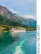 Купить «P&O Cruises cruise liner Ventura moored in Olden at the end of Innvikfjorden in western Norway», фото № 32341637, снято 7 августа 2020 г. (c) Николай Коржов / Фотобанк Лори