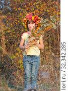 Купить «Девочка в венке из осенних листьев с букетом в руках», фото № 32342285, снято 26 октября 2019 г. (c) WalDeMarus / Фотобанк Лори