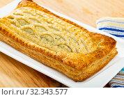Delicious salmon puff pastry pie closeup. Стоковое фото, фотограф Яков Филимонов / Фотобанк Лори