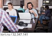 Купить «Freelancer in headset discussing online», фото № 32347141, снято 16 марта 2019 г. (c) Яков Филимонов / Фотобанк Лори