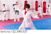 Купить «Boy in kimono exercising new techniques», фото № 32349537, снято 26 мая 2020 г. (c) Яков Филимонов / Фотобанк Лори