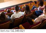 Купить «Young audience expecting movie to begin», фото № 32349821, снято 3 декабря 2016 г. (c) Яков Филимонов / Фотобанк Лори