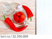 Купить «Recipe for baked home-canned bell peppers with garlic in a jar with mockup and copy space. Vetarian healthy food, healthy nutrition, homemade winter preparations», фото № 32350009, снято 15 сентября 2019 г. (c) Светлана Евграфова / Фотобанк Лори