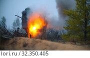 A man soldier holding lit flare outdoors on the field. Стоковое видео, видеограф Константин Шишкин / Фотобанк Лори