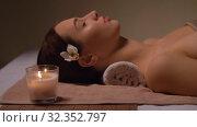 Купить «young woman lying at spa or massage parlor», видеоролик № 32352797, снято 19 октября 2019 г. (c) Syda Productions / Фотобанк Лори