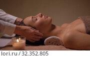Купить «woman having face and head massage at spa», видеоролик № 32352805, снято 19 октября 2019 г. (c) Syda Productions / Фотобанк Лори