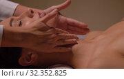 Купить «woman having face and head massage at spa», видеоролик № 32352825, снято 19 октября 2019 г. (c) Syda Productions / Фотобанк Лори