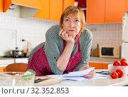 Купить «Worried housewife checking utility bills», фото № 32352853, снято 25 января 2020 г. (c) Яков Филимонов / Фотобанк Лори
