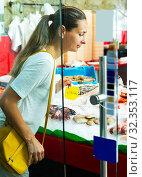 Купить «woman choosing fresh seafood from large assortment», фото № 32353117, снято 9 декабря 2019 г. (c) Яков Филимонов / Фотобанк Лори
