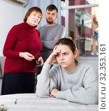 Купить «Upset woman during quarrel with family», фото № 32353161, снято 27 ноября 2017 г. (c) Яков Филимонов / Фотобанк Лори
