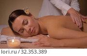 Купить «close up of woman having back massage at spa», видеоролик № 32353389, снято 19 октября 2019 г. (c) Syda Productions / Фотобанк Лори