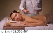 Купить «woman and cosmetologist applying clay mask in spa», видеоролик № 32353461, снято 19 октября 2019 г. (c) Syda Productions / Фотобанк Лори