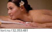 young woman lying at spa or massage parlor. Стоковое видео, видеограф Syda Productions / Фотобанк Лори