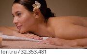 Купить «young woman lying at spa or massage parlor», видеоролик № 32353481, снято 19 октября 2019 г. (c) Syda Productions / Фотобанк Лори
