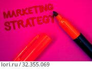Купить «Conceptual hand writing showing Marketing Strategy. Business photo text Plan Formula Creativity Research Organization Magenta color platform dark red color tidings corner red marker», фото № 32355069, снято 18 ноября 2019 г. (c) easy Fotostock / Фотобанк Лори