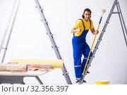 Купить «Young man contractor doing renovation at home», фото № 32356397, снято 4 июня 2019 г. (c) Elnur / Фотобанк Лори