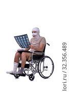 Купить «Injured man in wheel-chair isolated on white», фото № 32356489, снято 17 мая 2019 г. (c) Elnur / Фотобанк Лори