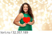 Купить «happy woman holding red heart over lights», фото № 32357189, снято 15 сентября 2019 г. (c) Syda Productions / Фотобанк Лори