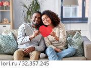Купить «happy african american couple with heart at home», фото № 32357245, снято 22 сентября 2019 г. (c) Syda Productions / Фотобанк Лори