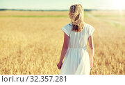 Купить «young woman in white dress on cereal field», фото № 32357281, снято 31 июля 2016 г. (c) Syda Productions / Фотобанк Лори