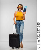 Купить «happy young woman with air ticket and travel bag», фото № 32357345, снято 30 сентября 2019 г. (c) Syda Productions / Фотобанк Лори