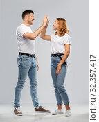 Купить «happy couple making high five gesture», фото № 32357417, снято 6 октября 2019 г. (c) Syda Productions / Фотобанк Лори