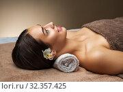 Купить «young woman lying at spa or massage parlor», фото № 32357425, снято 13 октября 2019 г. (c) Syda Productions / Фотобанк Лори
