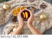 Купить «hands with glass of hot mulled wine on christmas», фото № 32357449, снято 4 октября 2018 г. (c) Syda Productions / Фотобанк Лори
