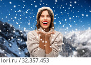 Купить «young woman in knitted winter hat in mountains», фото № 32357453, снято 30 сентября 2019 г. (c) Syda Productions / Фотобанк Лори
