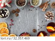 Купить «hot mulled wine, orange slices, raisins and spices», фото № 32357469, снято 4 октября 2018 г. (c) Syda Productions / Фотобанк Лори