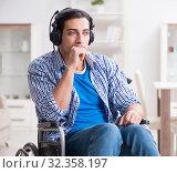 Купить «Disabled man listening to music in wheelchair», фото № 32358197, снято 5 декабря 2017 г. (c) Elnur / Фотобанк Лори