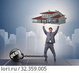 Купить «Businessman in mortgage debt financing concept», фото № 32359005, снято 11 июля 2020 г. (c) Elnur / Фотобанк Лори