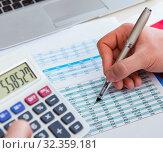 Купить «Finance analyst looking and financial reports», фото № 32359181, снято 2 марта 2017 г. (c) Elnur / Фотобанк Лори