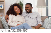 Купить «happy african american couple hugging at home», видеоролик № 32359997, снято 17 октября 2019 г. (c) Syda Productions / Фотобанк Лори