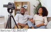 Купить «couple of video bloggers with camera at home», видеоролик № 32360077, снято 17 октября 2019 г. (c) Syda Productions / Фотобанк Лори