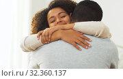 Купить «happy african american couple hugging at home», видеоролик № 32360137, снято 17 октября 2019 г. (c) Syda Productions / Фотобанк Лори