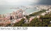 Купить «Panoramic view of Mediterranean coastal city of Malaga with harbor, Spain», видеоролик № 32361529, снято 18 апреля 2019 г. (c) Яков Филимонов / Фотобанк Лори