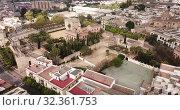 Купить «Aerial panoramic view of Jerez de la Frontera cityscape with Cathedral of Holy Saviour and Moorish alcazar, Spain», видеоролик № 32361753, снято 19 апреля 2019 г. (c) Яков Филимонов / Фотобанк Лори