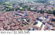 Купить «Picturesque aerial view of historic centre of Cividale del Friuli with Cathedral of Santa Maria Assunta on sunny autumn day, Italy», видеоролик № 32365545, снято 3 сентября 2019 г. (c) Яков Филимонов / Фотобанк Лори