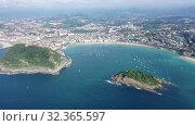 Купить «Aerial panoramic view of summer seascape with La Concha Bay and coastal city of San Sebastian, Basque Country, Spain», видеоролик № 32365597, снято 16 июля 2019 г. (c) Яков Филимонов / Фотобанк Лори