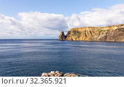 Scenic view from Jasper beach near St. George Monastery to Cape Fiolent in sunny summer day. Rocky coast black sea and cliff, Sevastopol, Crimea, Russia. Landscape Mountains surround the bay (2019 год). Редакционное фото, фотограф Алексей Ширманов / Фотобанк Лори