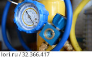 Купить «HVAC Repair Close-Up Vacuum pump, pressure gauge, manifold for Repair and Installation of refrigerators, air conditioners, ventilation, heating», видеоролик № 32366417, снято 2 ноября 2019 г. (c) Mikhail Erguine / Фотобанк Лори