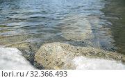 Water, rocky shore of the lake, calm wave, landscape. Стоковое видео, видеограф Mikhail Erguine / Фотобанк Лори